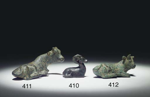 AN EGYPTIAN BRONZE WEIGHT IN T