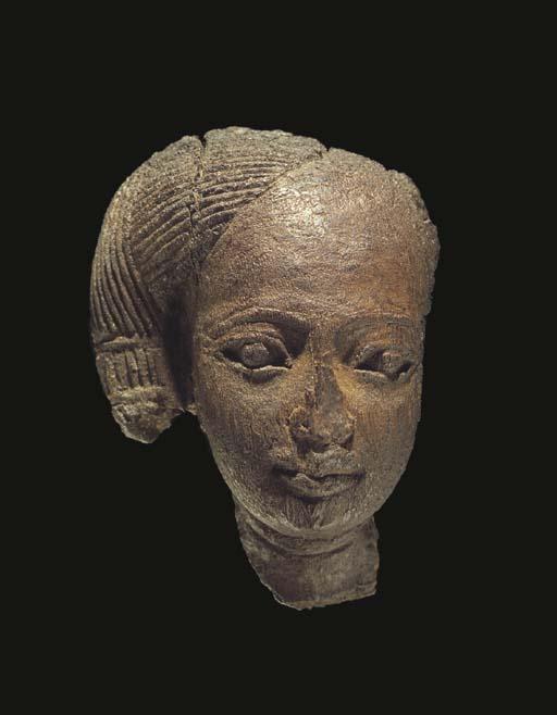 AN EGYPTIAN BURNT WOOD HEAD OF