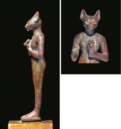 AN EGYPTIAN BRONZE STATUE OF B