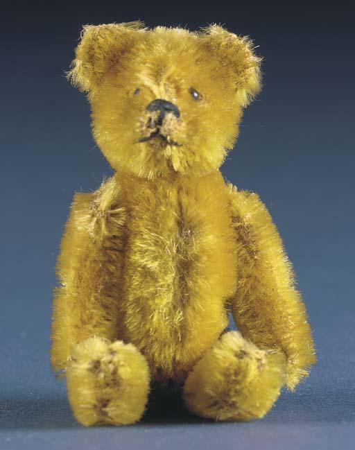A Schuco teddy bear compact