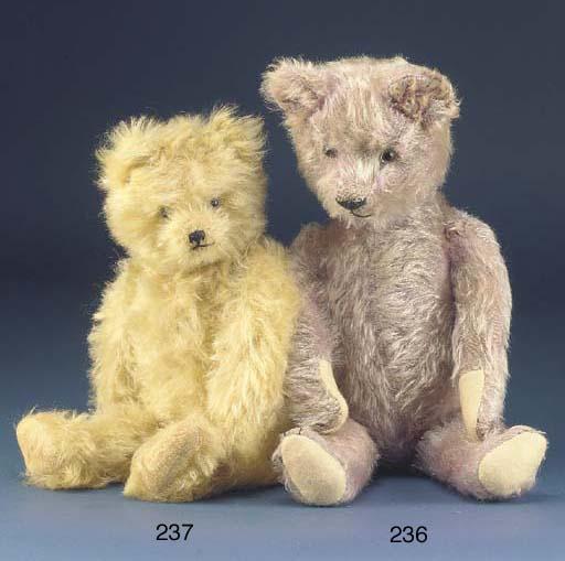 A lavendar mohair teddy bear