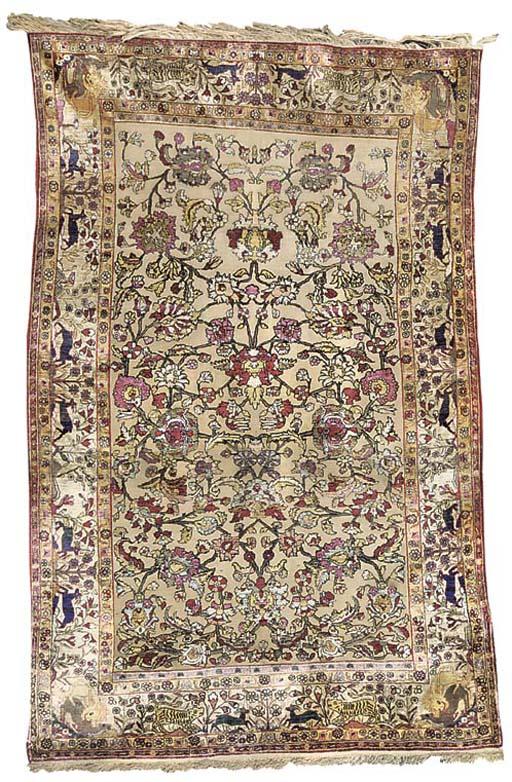 A fine silk souf Kashan rug