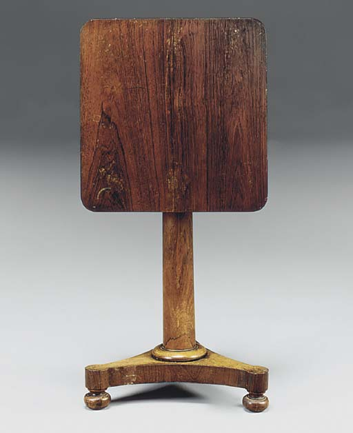 A ROSEWOOD OCCASIONAL TABLE