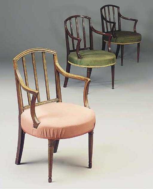 A SET OF THREE OPEN ARMCHAIRS