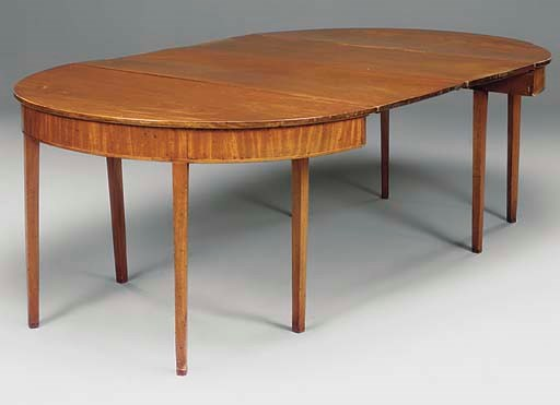 A mahogany and inlaid dining t