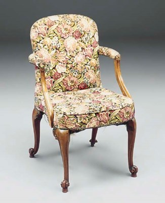 A mahogany and upholstered arm