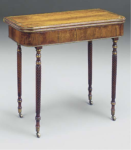 A REGENCY ROSEWOOD AND GILT-ME