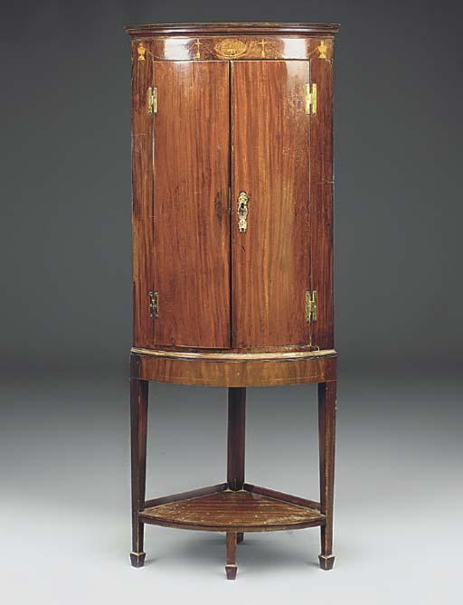 A mahogany and inlaid bowfront