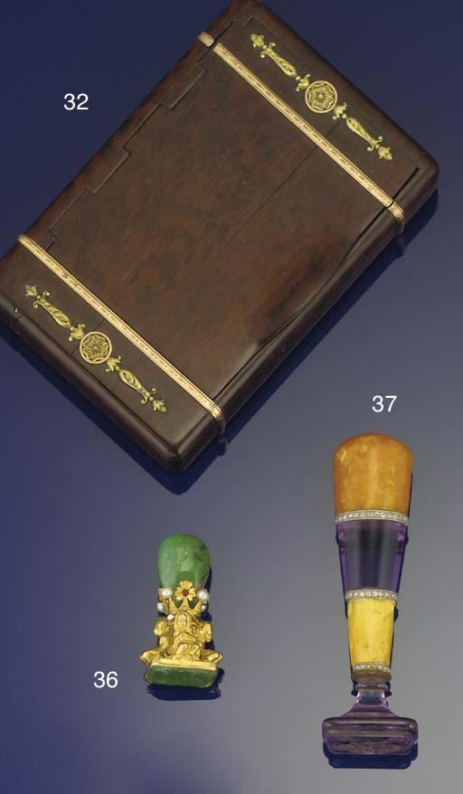 A hardwood cigarette case by F
