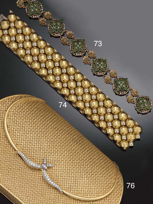 An emerald and diamond bracele