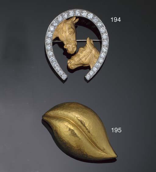 An 18ct. gold brooch by Tiffan