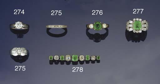 A diamond and emerald bar broo