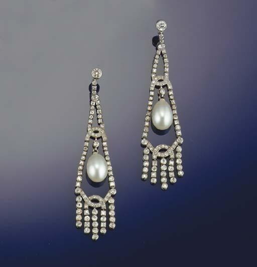 A pair of elegant pearl and di