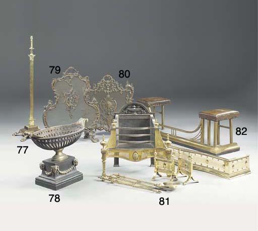 An Edwardian adjustable brass standard lamp