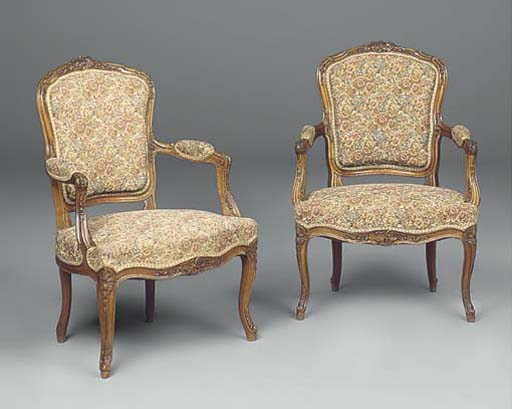 A pair of walnut and upholstered fauteuils