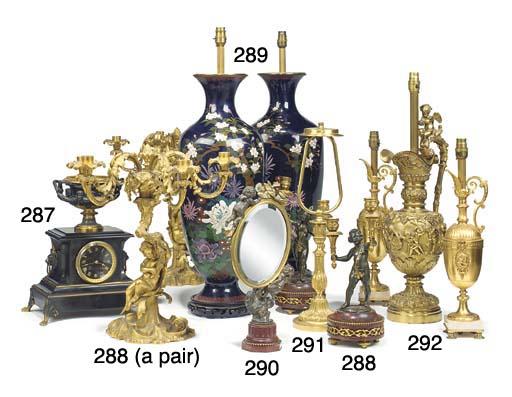 A Napoleon III silvered and gilt bronze toilet mirror