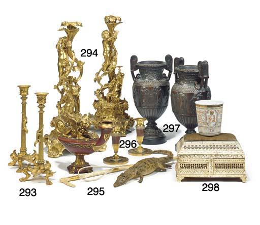 A set of four Victorian gilt metal candlesticks