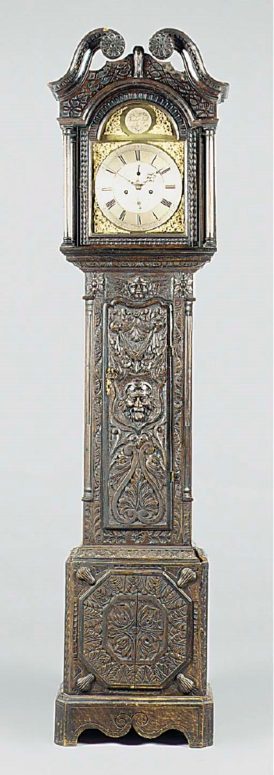 An English carved oak longcase