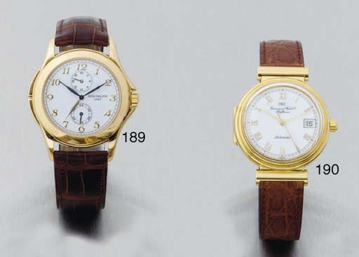 Patek Philippe. An 18ct Gold Water Resistant Dual Time Wristwatch