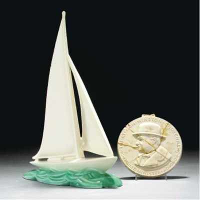 A POOLE POTTERY RACING YACHT,