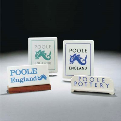 A GROUP OF POOLE POTTERY SIGNS