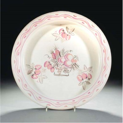 A POOLE TRIAL DISH PAINTED BY