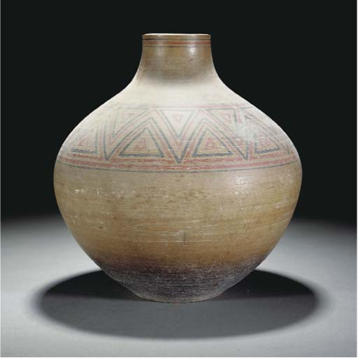 A POOLE POTTERY VASE BY GUY SY