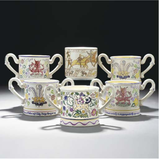 A POOLE POTTERY LOVING CUP PAI