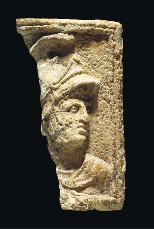 A ROMAN BONE RELIEF WITH HELME