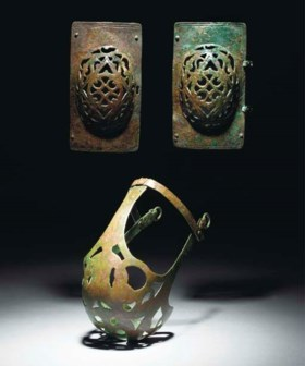 A PAIR OF ROMAN BRONZE HORSE EYE GUARDS