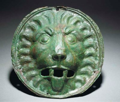 A ROMAN SHEET BRONZE LION HEAD