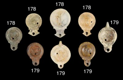 FIVE ROMAN TERRACOTTA OIL LAMP
