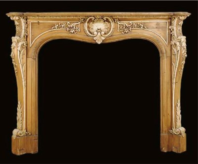 A PINE AND GESSO CHIMNEYPIECE