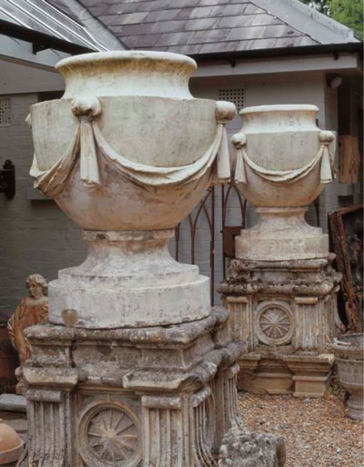 A PAIR OF COADE STONE URN FINI