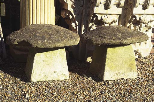 A PAIR OF LOW STADDLE STONES