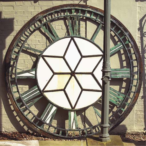 A LARGE COPPER AND IRON CLOCK