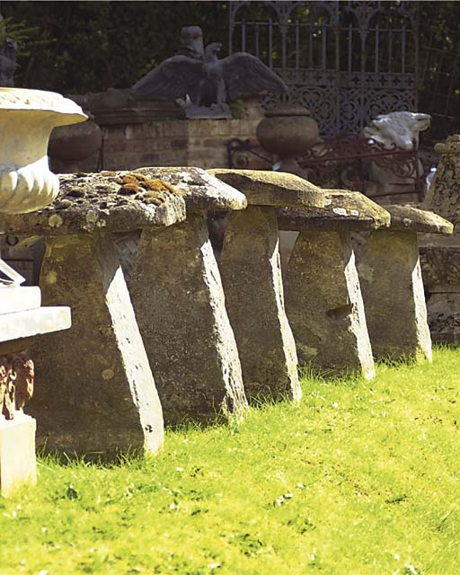 A GROUP OF FIVE STADDLE STONES