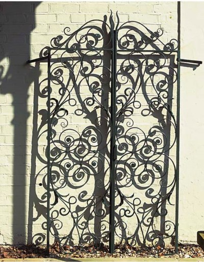 A PAIR OF ENGLISH WROUGHT IRON