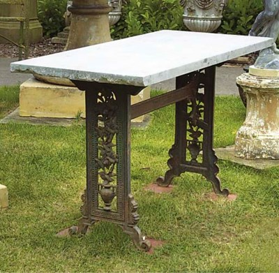 AN ENGLISH CAST IRON TABLE