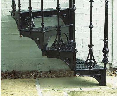 A CAST IRON SPIRAL STAIRCASE