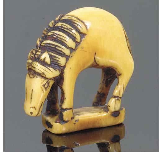 A Japanese ivory netsuke of a grazing horse, 18th Century