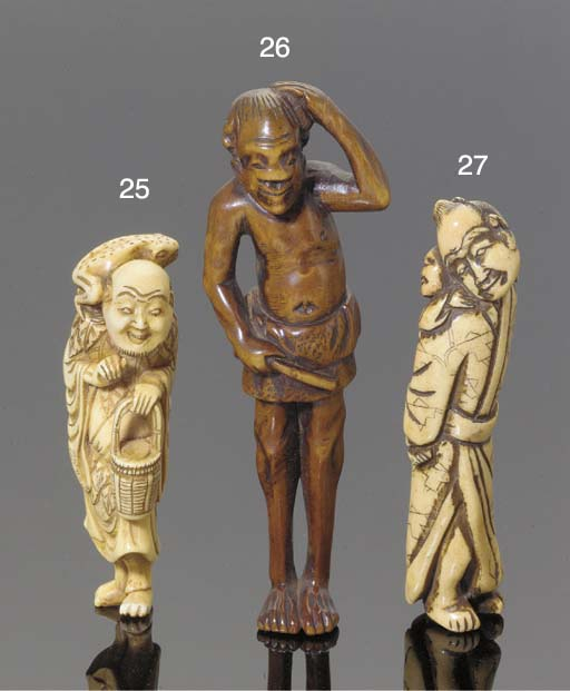 A Japanese wood netsuke of a f