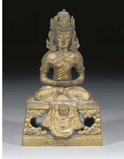 A Chinese gilt copper figure o