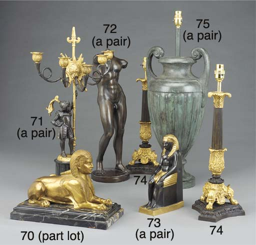 A gilt metal model of seated E