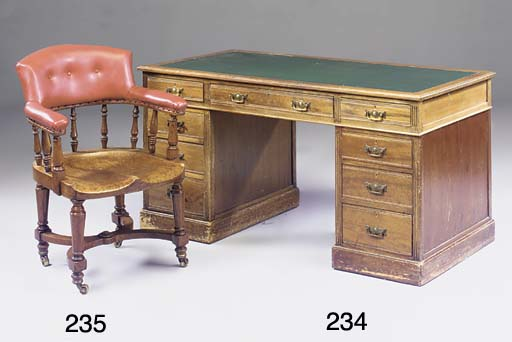 A Victorian oak and upholstere