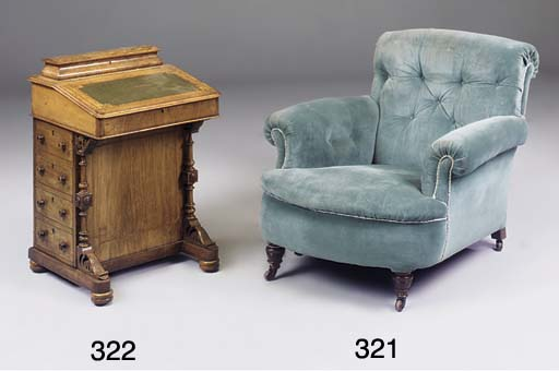 AN EDWARDIAN UPHOLSTERED EASY