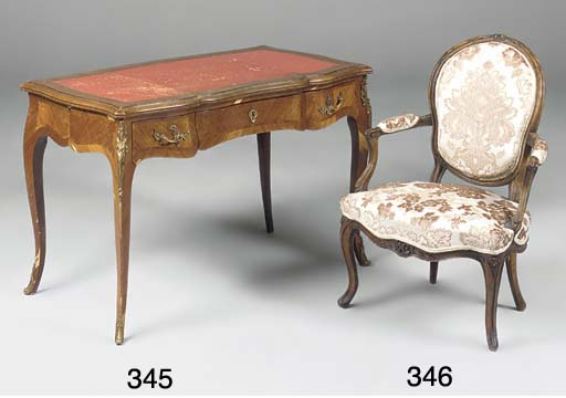 A FRENCH BEECH AND UPHOLSTERED