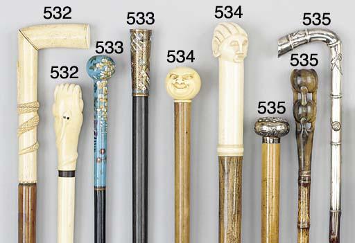 A Charles X carved ivory walki