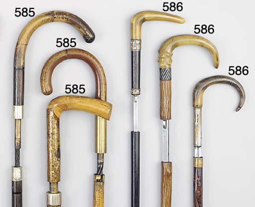 A horn mounted ebony sword sti