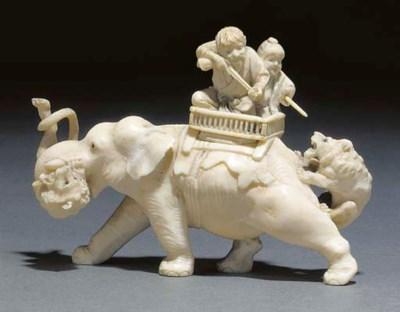 A Japanese ivory okimono of hu